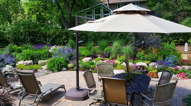 backyard oasis, garden in the city, patio, relaxing, landscaping, family project, diy, rocks, lavender, sage, umbrella, lounge chair, bubbling boulder, tiki torches, master gardener, eroseco