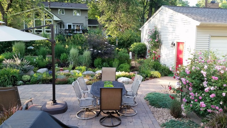 backyard oasis, garden in the city, patio, relaxing, landscaping, family project, diy, rocks, lavender, sage, umbrella, lounge chair, bubbling boulder, tiki torches, master gardner